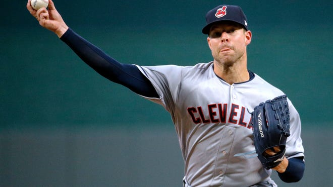 Cleveland Indians starting pitcher Corey Kluber throws during the first inning of a baseball game against the Kansas City Royals on Saturday, Sept. 29, 2018, in Kansas City, Mo. (AP Photo/Charlie Riedel)