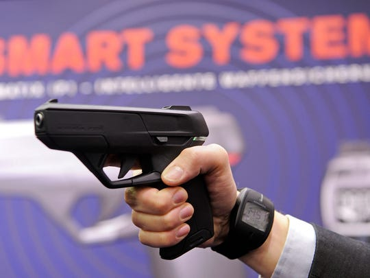 An employee of Armatix demonstrated a smart gun equipped with a radio frequency transmitter at the International Weapons trade fair in Nuermberg, Germany, in March 2010.