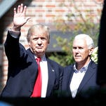 Republican presidential candidate Donald Trump waves to media after a meeting with Indiana Gov. Mike Pence at the Governor's Mansion in Indianapolis on July 13, 2016. Trump and members of his family — including his sons Donald Jr. and Eric — were seen leaving the residence at 46th and Meridian street in a motorcade at about 10:30 a.m. The meeting concluded without a statement.