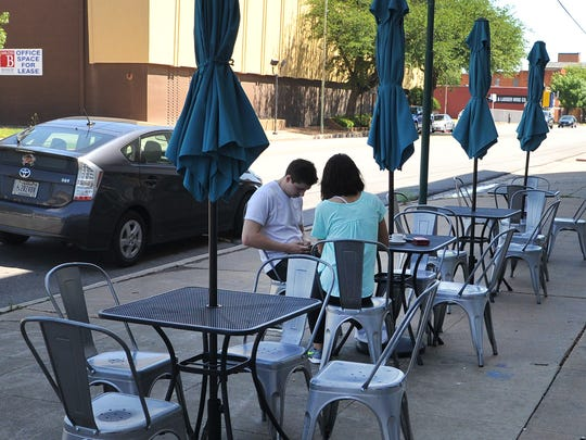 A young couple shares a table outside of the Odd Duck Coffee located in downtown Wichita Falls. Odd Duck co-owner, Andrea Klopf says, the city of Wichita Falls has decided to uphold its outdoor seating ordinance after the bond election failed in early May of this year.