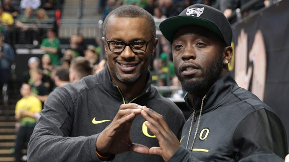 Feb 16, 2017; Eugene, OR, USA; Willie Taggart Oregon Ducks head football coach and De'Anthony Thomas watch the game from the sideline against the Utah Utes at Matthew Knight Arena. Mandatory Credit: Scott Olmos-USA TODAY Sports