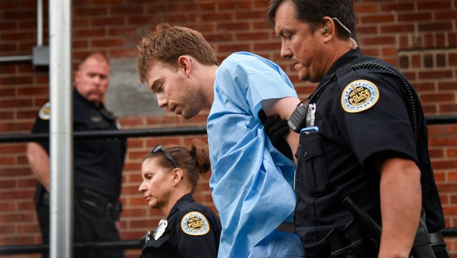Travis Reinking, the suspect in a deadly shooting at an Antioch Waffle House, is escorted into Hill Detention Center for booking in Nashville on Monday, April 23, 2018.