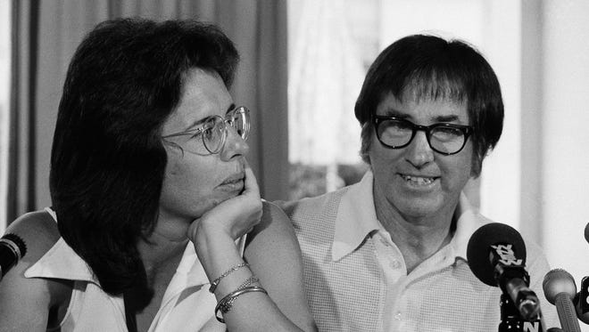 "Billie Jean King (left) and Bobby Riggs face reporters at a New York conference on July 11,1973, two months before their ""Battle of the Sexes"" match."
