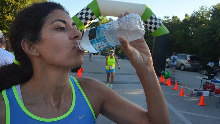 File: Clara Alber rehydrates after completing the course,