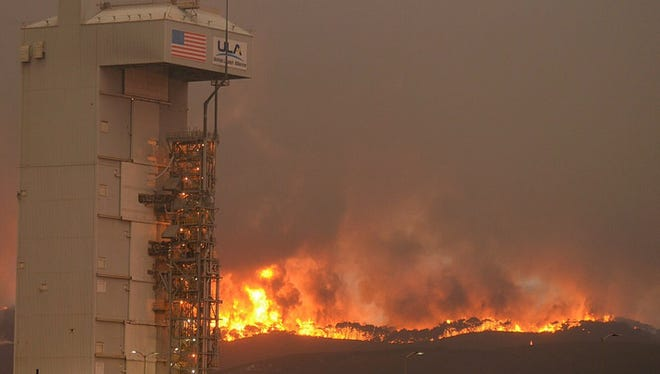 A wildfire has burned more than 10,000 acres near Vandenberg Air Force Base, officials said Tuesday.