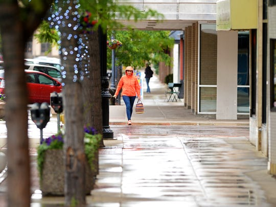 Pedestrians needed their raincoats on Tuesday afternoon's storm in downtown Great Falls. Rain is expected to  fall in Great Falls through Tuesday night.