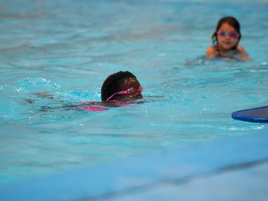 Amara Ochsner plays in the Morony Natatorium Pool during a Great Falls Rec Center camp, Friday.
