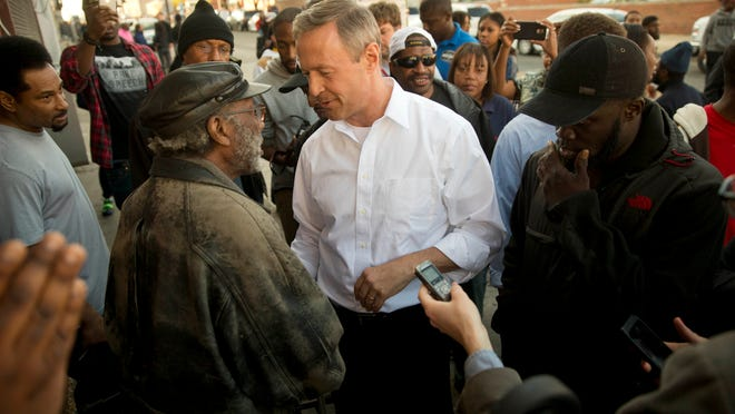 Former Maryland Gov. Martin O'Malley, center, meets with residents Tuesday, April 28, 2015, in Baltimore. Baltimore was a city on edge Tuesday as hundreds of National Guardsmen patrolled the streets against unrest for the first time since 1968, hoping to prevent another outbreak of rioting. (AP Photo/Matt Rourke) ORG XMIT: MDMR123