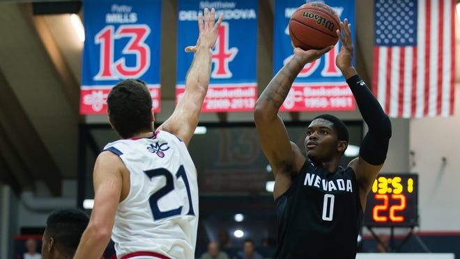 Wolf Pack forward Cameron Oliver shoots against St. Mary's center Evan Fitzner during their game Friday.