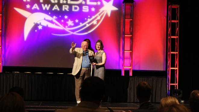 Ray Urban receives a lifetime achievement award for his work in the tourism and hospitality industry during the 2015 P.R.I.D.E. Awards.