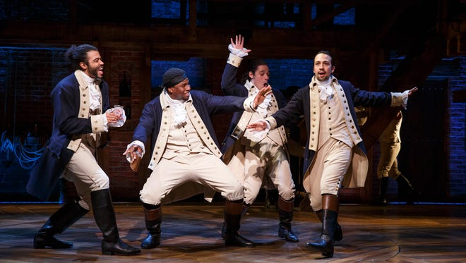 Daveed Diggs, Okieriete Onaodowan, Anthony Ramos, and Lin-Manuel Miranda in a scene from 'Hamilton.'