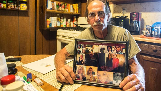 Billy Sechrist, of York City, holds a photo collage of his daughter, Shania, at his home Friday, May 27, 2016. Shania Sechrist, who was 15 and a student at William Penn Senior High School, took her own life after she came home from school Wednesday. Amanda J. Cain photo
