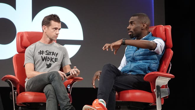 Twitter CEO Jack Dorsey, left, and civil rights activist DeRay Mckesson, right, at the Code conference in Rancho Palos Verde, Calif. June 1, 2016.