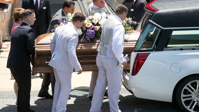 Pallbearers load the casket of Amanda Strous on Saturday, June 25, 2016, at Aldersgate United Methodist Church in York Township. Strous, 27, of Dallastown, was a victim of homicide June 18, according to police in North Carolina, where she had been living. Amanda J. Cain photo
