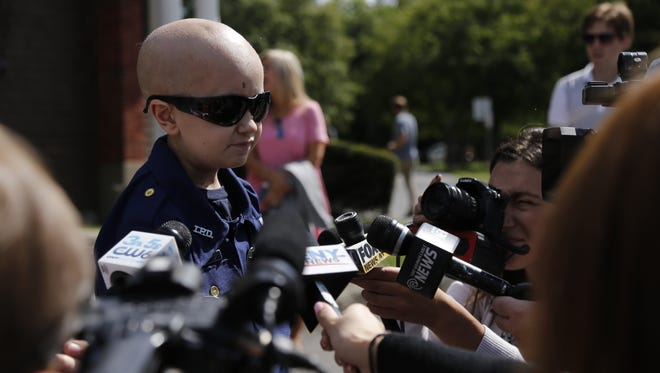 Colin Hayward Toland, a 9-year-old battling brain cancer, was sworn in as an honorary Ithaca City Police officer on Monday, September 12.