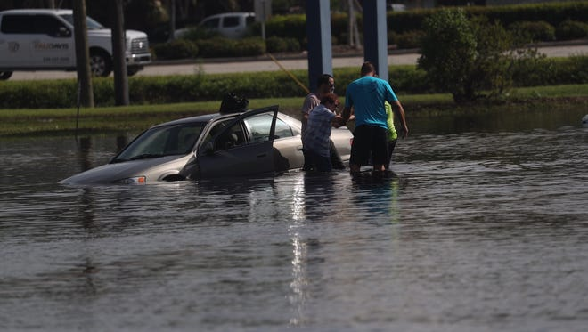 Island Park resident Mary Beekman was rescued from her flooded car by Bryan Heath, Andrew Kerinuk and John Joshua on Tuesday, Aug. 29, 2017.