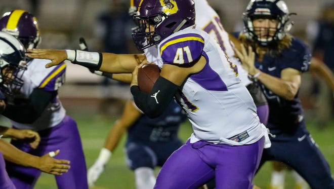 Salinas' Mike Cortez carries the ball during a CCS conference football game between the Salinas Cowboys and the Aptos Mariners at Aptos High School on Friday, November 3. 2017 in Aptos, Calif. Vernon McKnight/for The Californian