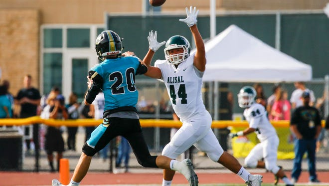 Christopher's Ben Sanford is challenged by Alisal's Anthony Blains during a Central Coast Section: Division IV semi-finals playoff football game between the Alisal Trojans and the Christopher Cougars at Christopher High School on Saturday, November 25, 2017 in Gilroy, Calif. Vernon McKnight/for The Californian