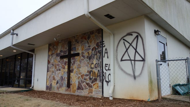 Deputies say vandals spray painted derogatory comments, in Spanish, toward Rev. Billy Graham on the outside of two church buildings.