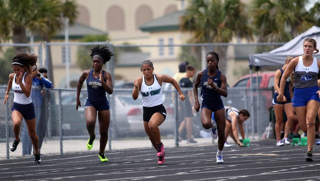 Athletes compete in the District 3A-12 meet at Palmetto Ridge High School on Friday.