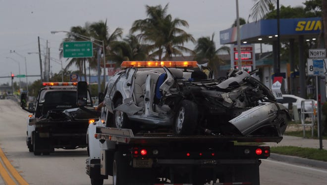 The remains of one of two cars involved in a crash at the top of the Matanzas Pass Bridge in Fort Myers Beach that sent four people to the hospital Monday morning.