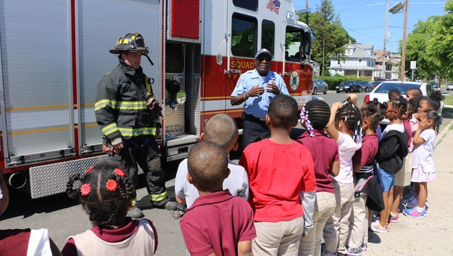 Plainfield Firefighter Neil Owens (left) and Plainfield Fire Division Inspector Rudi David attended Annual Career Day at Emerson School.