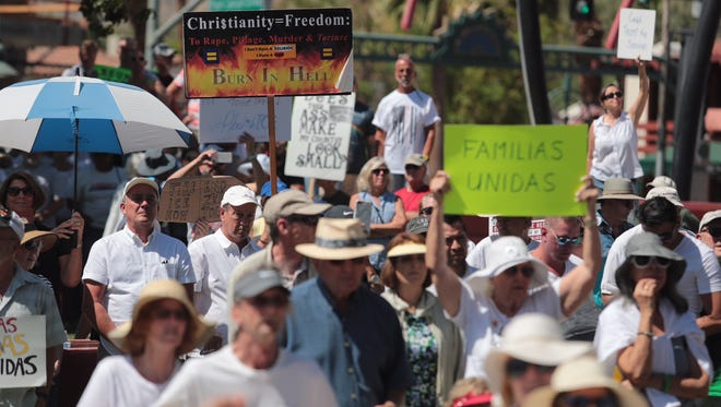 Hundreds of people attended a Keep Families Together rally at Frances Stevens Park along North Palm Canyon Drive in Palm Springs.