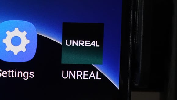 The UNREAL Mobile logo on a Samsung S7 smartphone