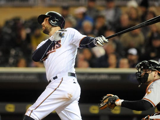 Minnesota Twins third baseman Trevor Plouffe (24) hits a home run, scoring two runs during the sixth inning against the Baltimore Orioles at Target Field in Minneapolis.