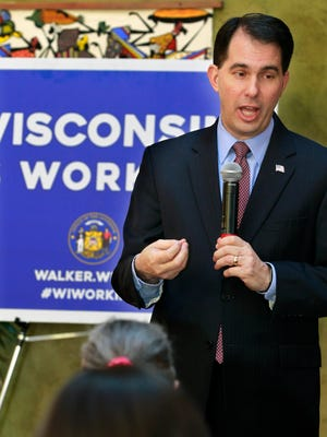 Gov. Scott Walker announces a $5 million grant through his budget bill at the north side center that brings children, the elderly and disabled together on Feb. 13.