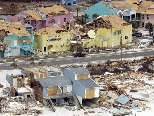 Beachfront homes in Perdido Key and along the highway lay in ruins from Ivan.