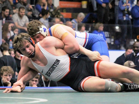 Catholic Central's Easton Turner (top) won by major