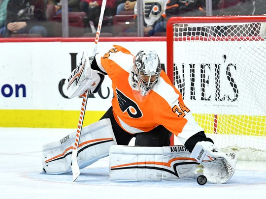 Mar 18, 2018; Philadelphia, PA, USA; Philadelphia Flyers goaltender Petr Mrazek covers the puck against the Washington Capitals during the first period at Wells Fargo Center.