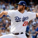 Dodgers pitcher Clayton Kershaw led the majors with 22 wins on his way to winning the NL Cy Young and MVP awards.