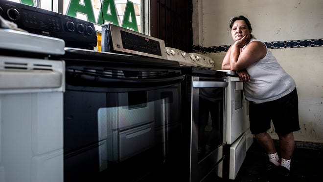 Maggie Diles, 53, has worked in her family's used appliance store for over 20 years.