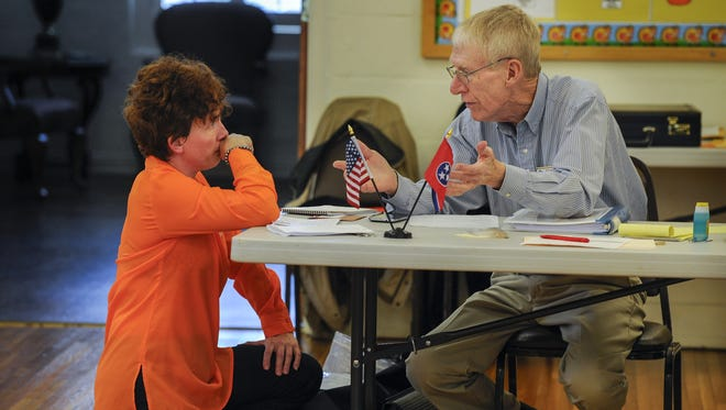 Campaign worker Shannon Freeman, left  gets instruction from Milton Cavender, a precinct director in Nashville. Incumbents on the Belle Meade, Forest Hills and Goodlettsville city commissions faced no challengers.