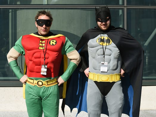 Fans dressed up as Batman and Robin.