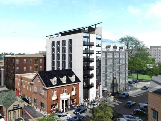 An updated rendering shows the seven-story project that will fill the former site of the Van Patten House at 7 S. Linn St.