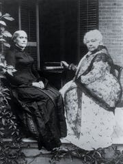 Susan B. Anthony, left, and Elizabeth Cady Stanton sit on the porch of the Anthony house in Rochester, N.Y., in this undated file photo. T