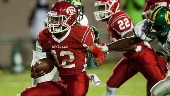 Lee quarterback Michael Huntley, Jr., runs for a touchdown against Carver at Cramton Bowl in Montgomery, Ala., on Friday September 23, 2016.
