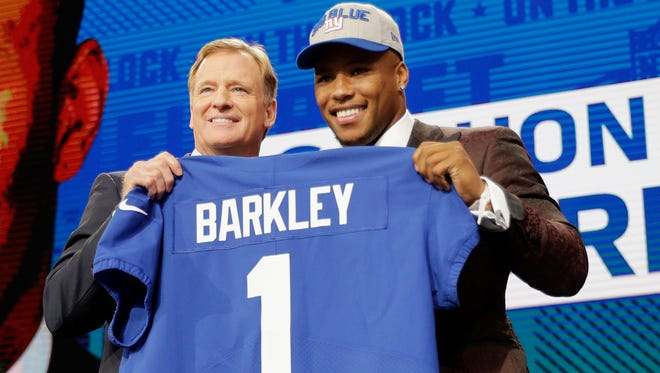 Penn State's Saquon Barkley, right, poses with commissioner Roger Goodell after being selected by the New York Giants during the first round of the NFL football draft, Thursday, April 26, 2018, in Arlington, Texas.