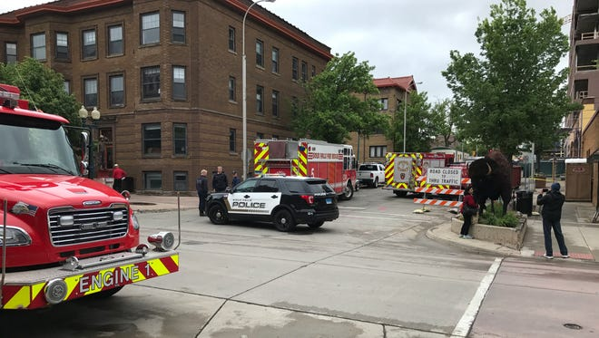 Crews on scene investigate a gas leak in downtown Sioux Falls on Friday.
