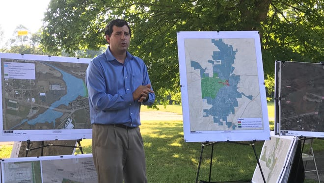 City engineer Bob Bianchi talks to members of Friends of North Lake Park Monday about the proposed dam project.