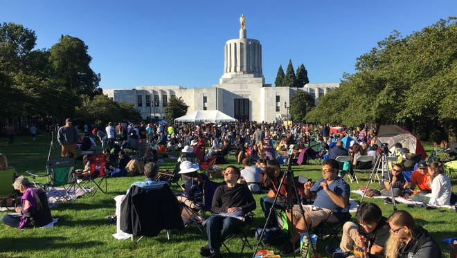 Eclipse watchers begin to fill the Capitol Mall in anticipation of the total solar eclipse on Monday, Aug. 21, 2017.