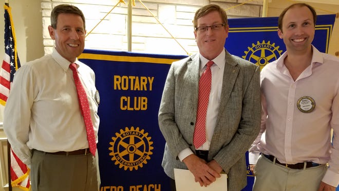 Rotary Club of Vero Beach president Daniel Fourmont, new member Tom Mitchell and past president Russell Twiss.