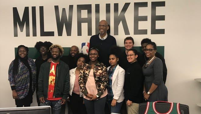 Kareem Abdul Jabbar takes a photo with members of Lead2Change and Teens Grow Greens after a Q&A session Tuesday at the Milwaukee Bucks offices