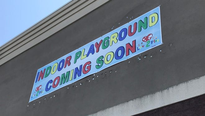 Luv 2 Play has a banner up on its future site in Grand Chute.
