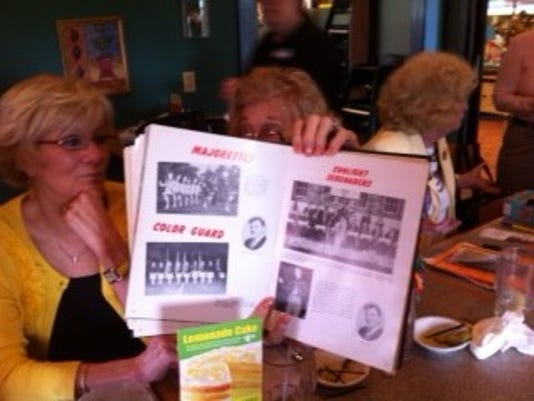 Teddie Waltemyer, left, and Joyce Paules, obscured by the yearbook, showed me some of the activities they were involved in at William Penn. Paules was a member of the Sunlight Serenaders -- the school's band. 'I loved that group,' she said.