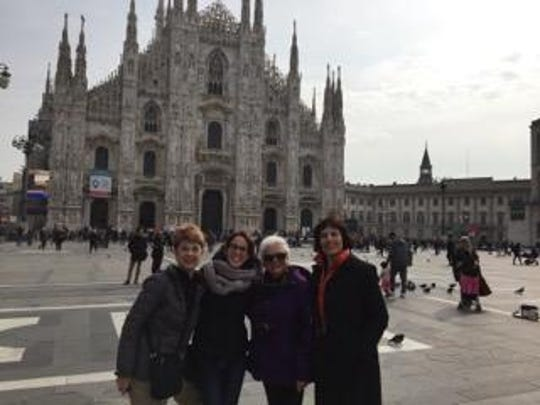 Sharon Reiter, Giulia Pellegrini, Frances Maggiore and Debbie O'Bryant pose in front of the Duomo of Milan.