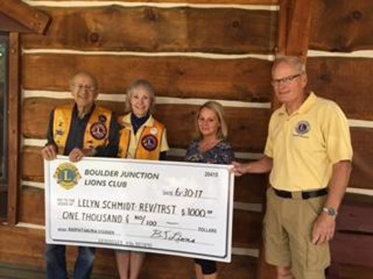 """The Boulder Junctions Lions Club presented a $1,000 donation to fulfill a pledge of $3,000, over a period of three years, to the """"Seeing for Lelyn"""" Foundation to benefit 4-year-old Lelyn Schmidt of Mercer. Lelyn was born with an extremely rare genetic eye disorder called Anophthalmia, which means either one or both eyes does not form. In Lelyn's case, he does not have either eye, leaving him permanently blind. He also has some hearing loss in one ear. The Lions donation will go toward covering Lelyn's medical treatment, care and devices. Pictured are The Boulder Junction Lions Club presenting their $1,000 donation to the """"Seeing for Lelyn"""" Foundation. Shown, from left to right, are Otis Voeltz, Boulder Junction Lions Club treasurer; Paula Pomainville, Boulder Junction Lions Club membership co-chair; Stormi Schmidt, Lelyn's mother; and Jeff Lucas, Boulder Junction Lions Club past president.Since Lions Clubs International was founded in 1917, Lions have worked on projects designed to prevent blindness, restore eyesight, and improve eye health and eye care for hundreds of millions of people worldwide. Indeed, sight is one of Lions defining causes. Through professional training, healthcare system development, and widespread drug treatment distribution, Lions have gained worldwide recognition for their work to improve sight and prevent blindness. Lions around the world are also actively involved in recycling eyeglasses at 18 centers worldwide, supporting Lions Eye Banks that provide eye tissue for sight-saving surgeries, screening the vision of hundreds of thousands of people every year, and preventing blindness by providing treatment to those at risk of losing their vision."""